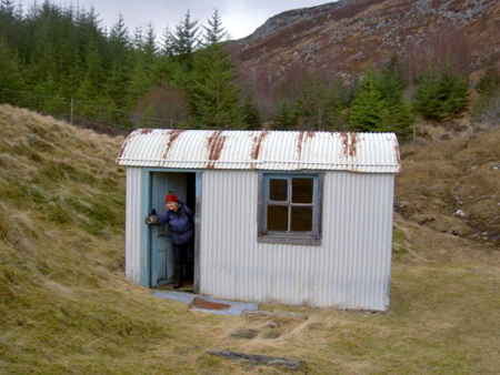"""Tea anyone?"" Clare at the stalkers bothy on the climb up to Beinn a'Chuallaich."